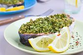 stock photo of crust  - Portion of a salmon with herbal crust served with fresh lemon - JPG