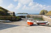 Boats in Mullion Cove harbour The Lizard peninsula south Cornwall UK