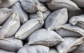 foto of sandbag  - Wall of sandbags for flood defense or military use - JPG