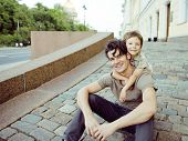 little son with father in city hagging and smiling