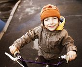 little cute boy on bicycle smiling closeup