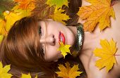 Fashion Woman Smiling Joyful Holding Autumn Yellow Maple Leaf In Mouth