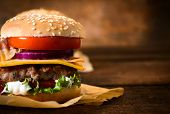 foto of beef-burger  - Close up to beef burger with cheese and vegetables.Blank space for text on the right side