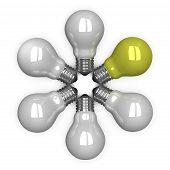 yellow Tungsten Light Bulb Among White Ones Lying Radially