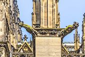stock photo of gargoyles  - ugly gargoyle sculpture at the dome in cologne - JPG