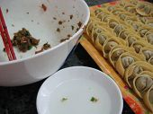 foto of wanton  - Homemade chinese dumpling or wanton ready to be cooked and eaten, deep fried or boil in water