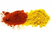 Red Pepper And Curry Spice Isolated On White Background