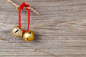 Christmas Bells On Wooden Background