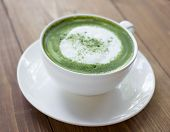 image of latte  - Matcha green tea latte beverage in glass on table - JPG