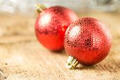 Two Red Decorative Balls On Wood Background. Selective Focus.