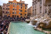 Tourists Near The Trevi Fountain In Rome, Italy