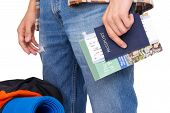 Hiker holding passport and tickets