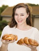 image of israel people  - A friendly young Jewish woman holding two challah loaves - JPG