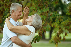 image of maturity  - Happy Mature couple dancing in the park in summer day - JPG
