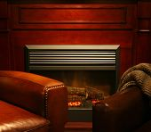 foto of comfort  - a comfortable cozy interior fireplace and cozy armchair in living room  of a living room space  toned with a retro vintage instagram filter effect - JPG