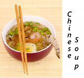 Chinese soup in bowl on bamboo mat background with space for your text