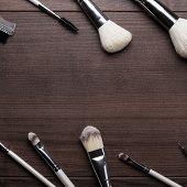 make-up brushes on wooden background