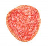 Slice of salami isolated on white background