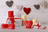 Romantic gift with candles on wooden background. Love concept