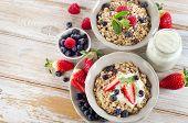 Muesli,  Ripe Berries And Yogurt For Healthy  Breakfast  On A Wooden Table