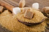 Brown Cane Sugar On  A Wooden Table