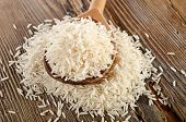 Uncooked Basmati Rice In  Wooden  Spoon