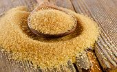 picture of sugar  - Brown Cane Sugar in a wooden spoon - JPG
