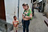 Black Child Local Resident Island Of Zanzibar Communicates With Tourist