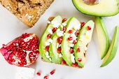picture of sunflower  - Avocado with Feta pomegranate and olive oil on sunflower seeds bread sandwich - JPG