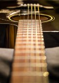 image of low-necked  - Guitar string shallow depth-of-field processed in warm tone