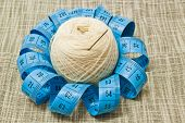 White Yarn With Needle And Blue Meter