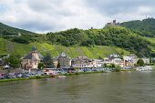 Medieval City Bernkastel With Tourists Making A River Cruise