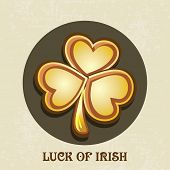 Happy St. Patrick's Day celebration sticker, tag or label design with glossy golden shamrock leaf on grungy background.