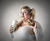 Chubby woman eating snacks