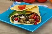 foto of aubergines  - Pita with roasted aubergine in board on wooden background - JPG