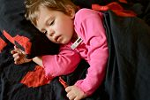 picture of laying-in-bed  - toddler girl is ill and she is laying in the bed - JPG