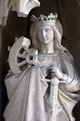 GRAZ, AUSTRIA - JANUARY 10, 2015: Saint Catherine of Alexandria on the portal of Parish Church of the Holy Blood in Graz, Styria, Austria on January 10, 2015.