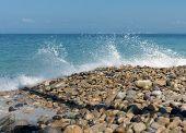 Water breaking on rock shore
