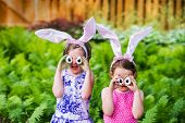Girls Wearing Bunny Ears And Silly Egg Eyes - Close Up
