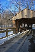 picture of covered bridge  - walkway leading to a covered bridge on a snow covered winter day  - JPG