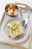 picture of serving tray  - breakfast with scrambled eggs tomato butter and toast on a serving tray - JPG