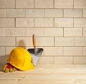 Brick Background, Trowel And Helmet