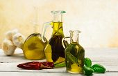 foto of flavor  - oil bottles flavored with herbs and spices - JPG