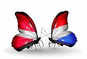 Two Butterflies With Flags On Wings As Symbol Of Relations Latvia And Luxembourg