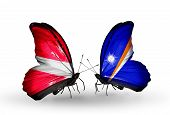 Two Butterflies With Flags On Wings As Symbol Of Relations Latvia And Marshall Islands