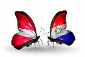 Two Butterflies With Flags On Wings As Symbol Of Relations Latvia And Paraguay