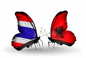 Two Butterflies With Flags On Wings As Symbol Of Relations Thailand And  Albania