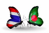 stock photo of bangladesh  - Two butterflies with flags on wings as symbol of relations Thailand and Bangladesh - JPG