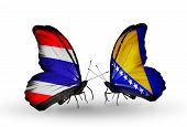 Two Butterflies With Flags On Wings As Symbol Of Relations Thailand And Bosnia And Herzegovina