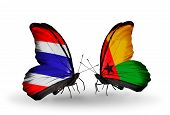 Two Butterflies With Flags On Wings As Symbol Of Relations Thailand And Guinea Bissau